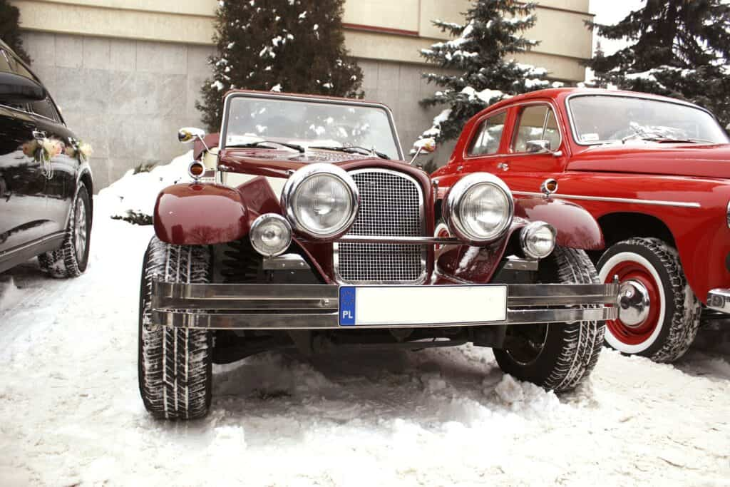 Old Car With Tires In Snow